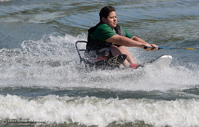 Isaias Chavez water skiis behind a MasterCraft driven by Matt Oberholtz as kids who rely on wheelchairs get an opportunity to water ski along side of former champions as coaches during the Ability First week-long camp in Chico, Calif. Tues. June 19, 2018.   (Bill Husa -- Enterprise-Record)