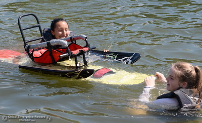 Helpers bring in one of the custom fitted water skiis as kids who rely on wheelchairs get an opportunity to water ski along side of former champions as coaches during the Ability First week-long camp in Chico, Calif. Tues. June 19, 2018.   (Bill Husa -- Enterprise-Record)