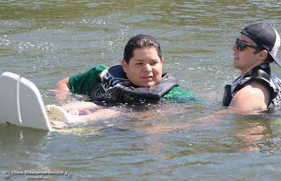 Isaias Chavez finishes up his run as kids get a chance to water ski along side of former champions as coaches during the Ability First week-long camp in Chico, Calif. Tues. June 19, 2018.   (Bill Husa -- Enterprise-Record)