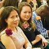 Nga Vu, left, and Kimberly Yean, both of Lowell, as they prepare to receive their English as a Second Language certificates Friday at the graduation ceremony of the Abisi Adult Education Center in Lowell. SUN/Robert Mills