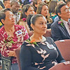 Na Van, at left, and Nawal Thyeb, center, prepare to receive their English as a Second Language certificates Friday at the graduation ceremony of the Abisi Adult Education Center in Lowell. SUN/Robert Mills