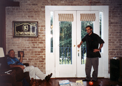 The wall of the den which was an exterior wall was 180-year-old exposed brick (three layers thick) and had the french doors to the balcony.<br /> That's dad on the left.