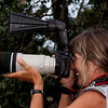 Linda taking pictures at the Alligator Farm in St. Augustine, Florida.  She is using a Better Beamer to extend the flash.