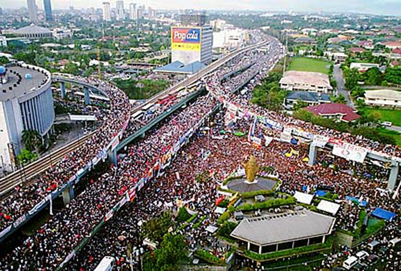 "A watershed moment. The People Power Revolution (also known as the EDSA Revolution and the Philippine Revolution of 1986) was a series of nonviolent and prayerful mass street demonstrations that occurred in 1986.  <br /> <br /> The majority of the demonstrations took place at Epifanio de los Santos Avenue, known more commonly by its acronym EDSA, and involved over 200,000 Filipino civilians as well as several political, military, and religious figures. The protests, fueled by a resistance and opposition of years of corrupt governance by Marcos, occurred from February 22 to 25 in 1986, when Marcos fled Malacañang Palace to the United States and conceded to Corazon Aquino as President of the Philippines.<br /> <br /> When the news of Marcos' departure reached the people, many rejoiced and danced in the streets. <br /> <br /> Many people around the world rejoiced and congratulated Filipinos they knew. Bob Simon, an anchorman at CBS said, ""We Americans like to think we taught the Filipinos democracy; well, tonight they are teaching the world.""<br /> <br /> It was at this spot during the 4-day revolution where my brothers and I drove and parked the car in front of a military tank to prevent it from advancing towards the people just a few meters in front of it. <br /> <br /> We stopped a tank! (I was so relieved that the tank withdrew and went back to its base. Imagine having to explain a flattened car to my dad. Phew!)"