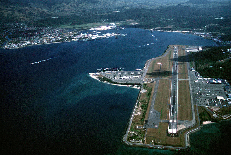 An aerial view of Subic Bay showing the Seaport and Airport. It is designated a Special Economic Freeport Zone.<br /> <br /> Subic Bay is approximately 4 n mi wide and 9 n mi long. The entrance to Subic Bay opens seaward, and Grande Island, located in the mouth of the bay, divides the entrance into two channels. The main channel, lying to the west of Grande Island is wide, deep, and can accommodate large ships and submarines.<br /> <br /> The port consists of an outer harbor and an inner basin. When Subic Bay was a US Navy installation, all facilities were available for assignment to US Navy vessels. The sheltering effect provided by the surrounding terrain qualifies Subic Bay as a much safer port in heavy weather than Hong Kong.<br /> <br /> The posh Subic Bay Yacht Club lies next to the port.<br /> <br /> The 12-15 June 1991, eruption of Mount Pinatubo volcano was the largest eruption in the past five decades and led to the largest recorded evacuation of people due to a volcanic threat. The cataclysm essentially ended the US military presence. US forces abandoned Clark Air Base and Subic Bay Naval Base after the Philippine government voted not to renew a basing agreement in 1992. After the cleanup, Subic Bay was reopened and designated a freeport.<br /> <br /> There is still a sizable retired US military personnel who chose to retire here.