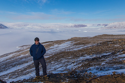 Me with a sea ice covered Wolstenholme Fiord and two glaciers