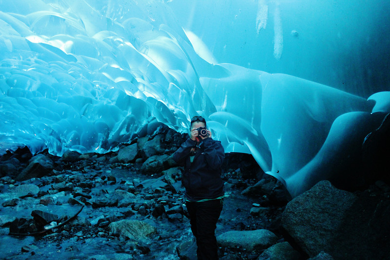 Taking pictures in an Ice Cave at the Mendenhall Glacier in Juneau, Alaska