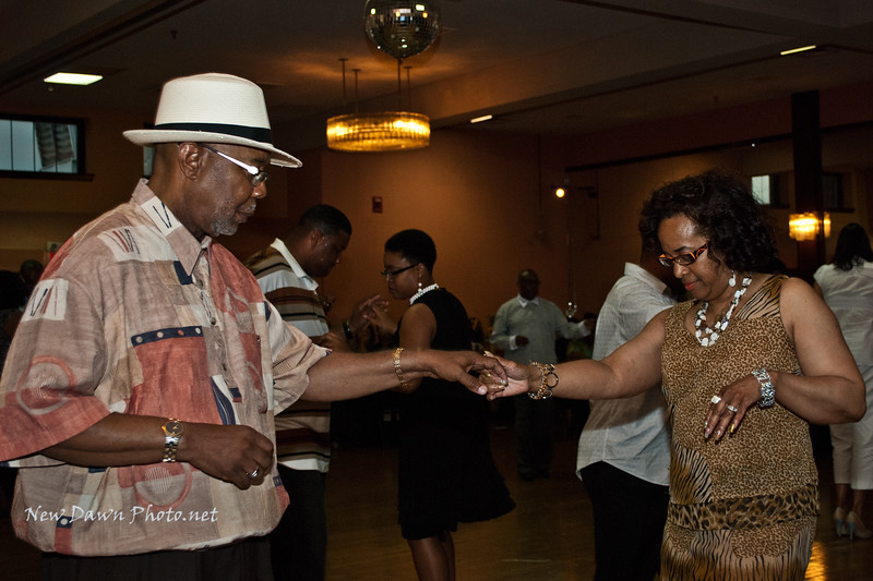 "Rev. Roosevelt Sanders & his beautiful bride, Stephanie, cut the rug at the 2009 ""Steppin' for the Hungry"" event for the Mozel Sanders Foundation."