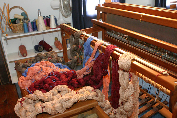 Getting ready to weave a plaid blanket - or two or three - from left-over wool that came from the Wortzels, the original owners of my loom, a gorgeous cherry-wood Norwood. I love working the wool, winding the warp, round and round, 240 ends, 6 ends per inch, 10 yards long - the wool tickles my fingers and the colors delight my eye and my soul. Next, the ends will be threaded through the reed, then through the heddles, tied on and wound, then the fun begins - the actual weaving. I love the rhythm, the order, the mechanics, and of course, the finished product. Stay tuned!