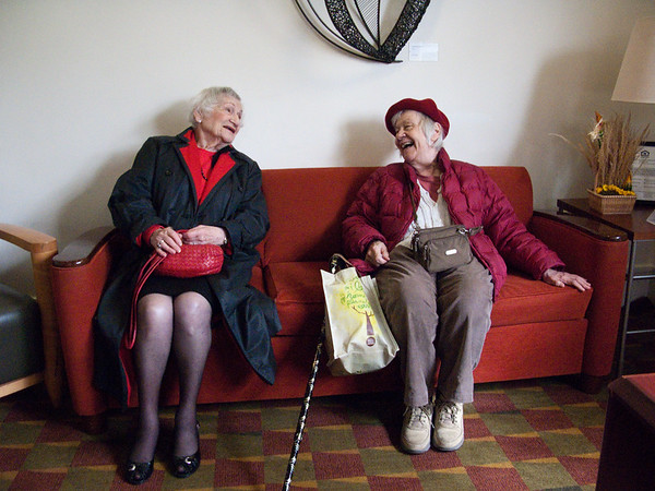 October 30, 2009. 1550 Beacon Street. Women on a Red Couch. Ready for an afternoon at the symphony.