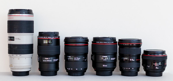 Here are my 6 Canon 'L' lenses. The 'L' denotes they are the flagship in terms of build, water sealing, sharpness and overall glass quality. From the left is the 'big fella' and is just such an incredible medium to long zoom lens. Ideal for portraits, or for getting in close from a distance without being too intrusive.  Second is my 100mm macro lens, specifically designed for those close up ring shots. Next is the 24-70 zoom (recently upgraded to the mark ii), its an all rounder on a wedding day, if the truth be known you could cover pretty much everything on a wedding day with this one lens (the other lenses are really specialist lenses with specific jobs to do). Fourth in line is the newest member of the team, the 85mm 1.4,  designed for portraiture and low light. Fifth is the 16-35 zoom, useful for larger groups and also some pretty funky shots where some artistic post processing comes into play. Last but not least is the 50mm 1.2, ideal for use in dark rooms, churches where no flash is allowed.