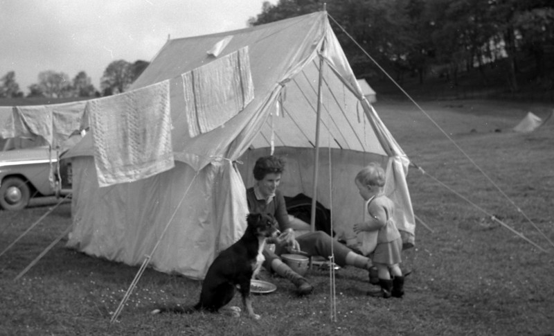 Me and my mom.<br /> <br /> Old style camping. The dog and I are of course helping mom prepare dinner.
