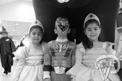 All decked out Four-and-a-half year old princesses Alexandra and Victoria Imad of Yarmouth are joined by their brother, Power Ranger Jay Imad, 6, at Cape Cod Museum of Natural History's Green Halloween Sunday at the museum in Brewster. More photos at WICKED LOCAL CAPE COD The Cape Codder NOVEMBER 4, 2011page 8