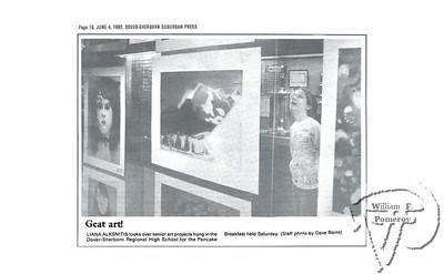 Great art!LIANA ALKSNITIS looks over senior art projects hung in the(Staff photo by Dave Rains)  Dover-Sherborn Suburban Press JUNE 4, 1992section two