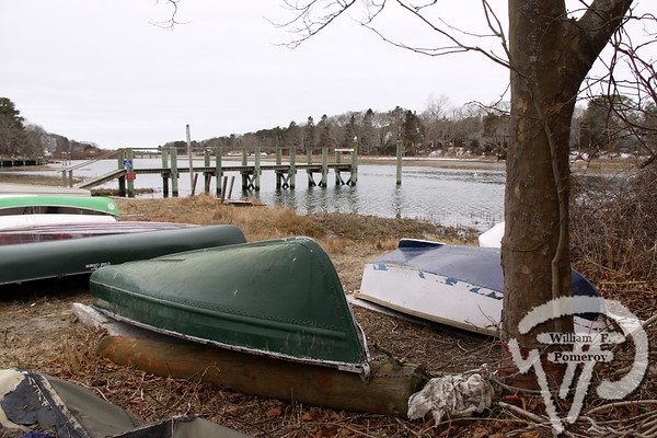 BOTTOMS UP Boats await warmer days  along Herring River.  Harwich Oracle February 27, 2013 front page