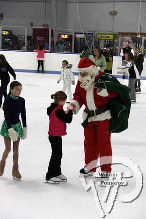 Harwich resident Ella Raye received a piece of candyduring the annual Santa Skate at the Charles Moore Arenain Orleans.  The skate benefited the Lower Cape Outreach Council. The Cape Codder DECEMBER 17, 2010page 35