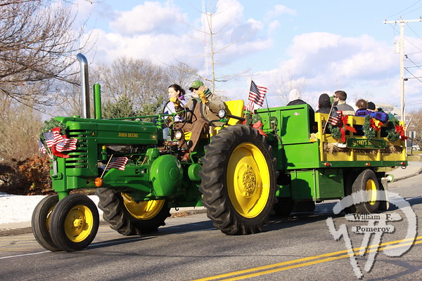 """Holiday cheerIt was """"A Seaside Christmas in Orleans"""" Saturday,when a slew of holiday festivities drew residents and visitors to town.. . . Sparky takes folks for a hayride down Old Colony Way... The Cape Codder DECEMBER 3, 2010page 19"""