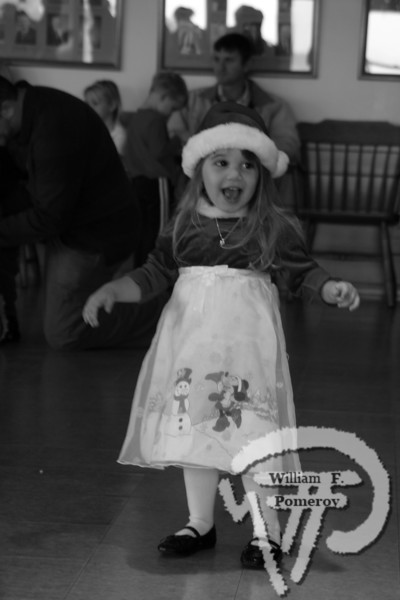 Three-year-old Gracie Leavitt of South Yarmouth takes partin Reindeer Games at Snow's in Orleans while waiting for Santa. The Cape Codder DECEMBER 5, 2008page 15