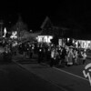 "<font style=""color: #dab25b; font-size: 14px; font-family: Century Gothic; font-weight: bold; font-style: italic;"">A candlelit procession strolls down Main Street to the Village Green last Saturday evening to kick off A Seaside Christmas in Orleans. </font>"