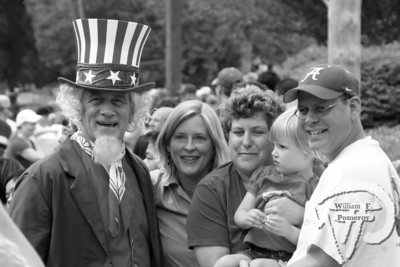 Uncle Sam (aka Mark Norgeot) hams it upwith some Orleans parade-goers. The Cape Codder JULY 11, 2008page 15