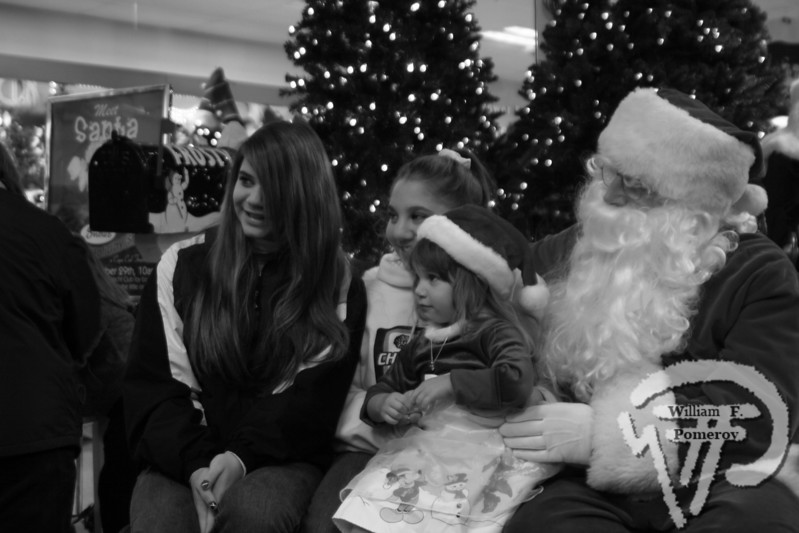 Megan, 12, Alicia, 14, and Gracie Leavitt, 3,have a chat with Santa at Snow's. The Cape Codder DECEMBER 5, 2008page 15