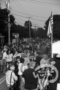 The street was closed off to traffic to accommodate a huge crowd.  The Cape Codder  AUGUST 19, 2011 page 33