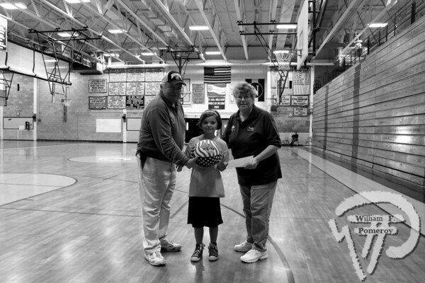 Hoop shoot winners move on to district finalsPete and Kathy Gill present Eastham resident Toni Youngwith a ball after she won her age group by sinking 11-of-25 free throwsduring last Saturday's competition. The Cape Codder NOVEMBER 19, 2010page 32