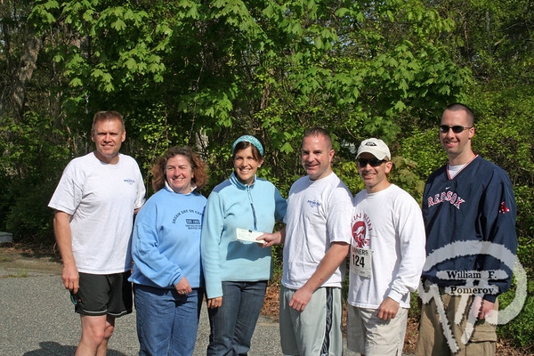 Dream runMembers of the Brewster Police Department present a check donatedto Dream Day on Cape Cod following the Run for the Hills at NickersonState Park in Brewster last weekend.  Geoff Newton was the top finisherwith a time of 18:22 while Orleans resident Sarah Newcomb was the topfemale finisher with a time of 23:30.Pictured left to right:Lt. George Bausch, Dianne Gilrein, Kathleen Giorgio, Sgt. Jon O'Leary,Officers Frank Mirisola and Charlie Mawn The Cape Codder MAY 22, 2009page 39