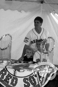 Dream dayDan Rabold of Brewster poses with his sons Jackson and Jakeand the 2007 World Series Championship Trophy.  The Red Sox prizemade a trip to Brewster Saturday before a Cape League game.Procceeds from photographs benefited Dream Day of Cape Cod'sCamp Nan-ke-Rafe for youngsters with life-threatening illnesses,among other organizations. The Cape Codder JULY 11, 2008page 8