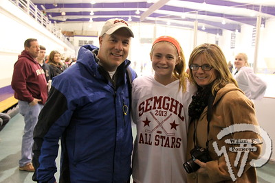 Barnstable High School Red Raiders'  Sarah Boule plus her mother and father.