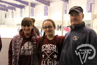 Falmouth High School Clippers'  Alexa Scribner along with her parents.