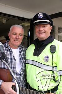 Singer/guitarist Dave Hickey  accompanies Chatham policeman John Whittle.