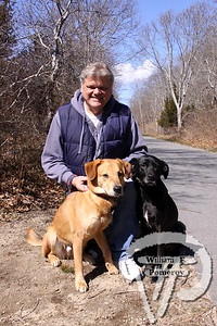 Mike Kuchyt of Eastham  with his rescue dogs Harley and Blaze. SEEN ON SCENE:  Along the  Cape Cod Rail Trail Along the Cape Cod Rail Trail mixed with warmer weather  this past Saturday heightened curiosity for some to explore  from Brewster to Wellfleet's town line.   2 — 12  WickedLocal.com/CapeCod April 1, 2013 COMMUNITY NEWSPAPER COMPANY