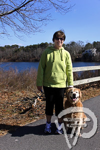 Lorraine Smith accompanies her golden retriever Ernie  from Eastham. SEEN ON SCENE:  Along the  Cape Cod Rail Trail Along the Cape Cod Rail Trail mixed with warmer weather  this past Saturday heightened curiosity for some to explore  from Brewster to Wellfleet's town line.   4 — 12  WickedLocal.com/CapeCod April 1, 2013 COMMUNITY NEWSPAPER COMPANY