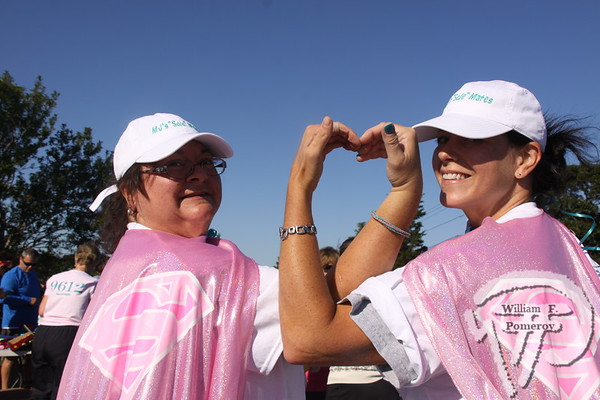 Brenda and Kimberlee Schuler,  supa' Annie's Bananies.  SEEN ON SCENE:  girlygirl P.A.R.T.S. fourth annual 5K Run/Walk for Ovarian Cancer girlygirl P.A.R.T.S. fourth annual 5K Run/Walk for Ovarian Cancer attracted over 900 participants to the Sandwich Boardwalk at Town Neck Beach this past Saturday. To learn more and/or donate to this cause, please visit them on-line at girlygirlParts.net Pre-screening Awareness Required To Silence... Ovarian Cancer brought together love, hugs and exercise!   8 of 25   WickedLocal.com/CapeCod September 9, 2013 COMMUNITY NEWSPAPER COMPANY