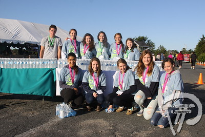 Event volunteers  keep participants hydrated.  SEEN ON SCENE:  girlygirl P.A.R.T.S. fourth annual 5K Run/Walk for Ovarian Cancer girlygirl P.A.R.T.S. fourth annual 5K Run/Walk for Ovarian Cancer attracted over 900 participants to the Sandwich Boardwalk at Town Neck Beach this past Saturday. To learn more and/or donate to this cause, please visit them on-line at girlygirlParts.net Pre-screening Awareness Required To Silence... Ovarian Cancer brought together love, hugs and exercise!   2 of 25   WickedLocal.com/CapeCod September 9, 2013 COMMUNITY NEWSPAPER COMPANY