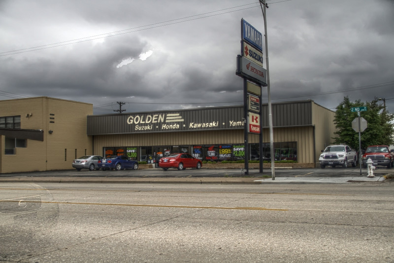 This is a HDR photo taken of the store where I work. Its 6 photos at different exposures and then merged together. A Nissan drove into the last photo, thats why you can see just a ghost of it.