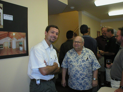 Owner Andy and Arnold share a moment at the grand opening.