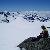 Silke having lunch at Solution Col looking back over the Olivine Ice Plateau