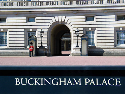 """London 11 - Buckingham Palace  Buckingham Palace is the official London residence of the British monarch. Located in the City of Westminster, the palace is a setting for state occasions and royal hospitality, and a major tourist attraction. It has been a rallying point for the British people at times of national rejoicing and crisis.  Originally known as Buckingham House, the building which forms the core of today's palace was a large townhouse built for the Duke of Buckingham in 1703 and acquired by George III in 1761[2] as a private residence, known as """"The Queen's House"""". It was enlarged over the next 100 years, principally by architects John Nash and Edward Blore, forming three wings around a central courtyard. Buckingham Palace finally became the official royal palace of the British monarch on the accession of Queen Victoria in 1837. The last major structural additions were made in the late 19th and early 20th centuries, including the present-day public face of Buckingham Palace. However, the palace chapel was destroyed by a German bomb in World War II; the Queen's Gallery was built on the site and opened to the public in 1962 to exhibit works of art from the Royal Collection.  This was taken through the front fence."""