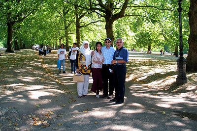 London 3 - St James's Park  Anita, my parents and I. Check the spelling, as St James' Park is the home ground for a certain non-Premier League team in Newcastle. We walking around there to get to Buckingham Palace.  St. James's Park is a 58 acre (23 hectare) park in Westminster, central London, the oldest of the Royal Parks of London. The park lies at the southernmost tip of the St. James's area, which was named after a leper hospital dedicated to St. James the Less.  St. James's Park is bounded by Buckingham Palace to the west, The Mall and St. James's Palace to the North, Horse Guards to the east, and Birdcage Walk to the south. The park has a small lake, St. James's Park Lake, with two islands, Duck Island (named for the lake's collection of waterfowl), and West Island. A bridge across the lake affords a view of Buckingham Palace framed by trees and fountains, and a view of the main building of the Foreign and Commonwealth Office, similarly framed, to the east.  The park is the most easterly of a near-continuous chain of parks that also comprise (moving westward) Green Park, Hyde Park and Kensington Gardens. The closest London Underground stations are St. James's Park, Victoria, and Westminster.