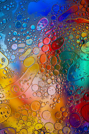 Oil  and water rainbow - vertical