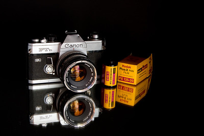Reflecting Back: 1971.  This is my first 'real' camera and a vintage box of film from 1971 also. Bought the film on eBay just to be authentic... Oh, and I am still a Canon loyalist.