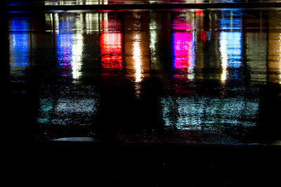 Who knew that asphalt reflections and a liquor store could be so pretty?