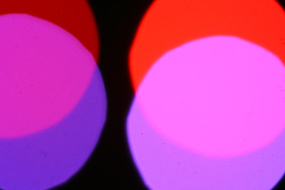 This is a photo of some stage lights (dance booms to be more exact).  I just blurred the focus to make it abstract.