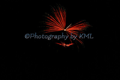 red fireworks in the shape of a dragonfly