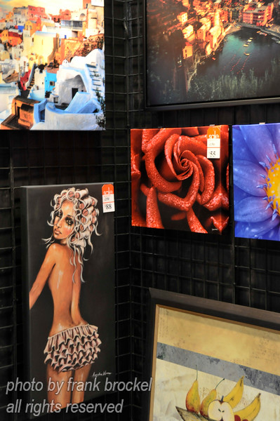 Pictures being displayed for sale at a trade show
