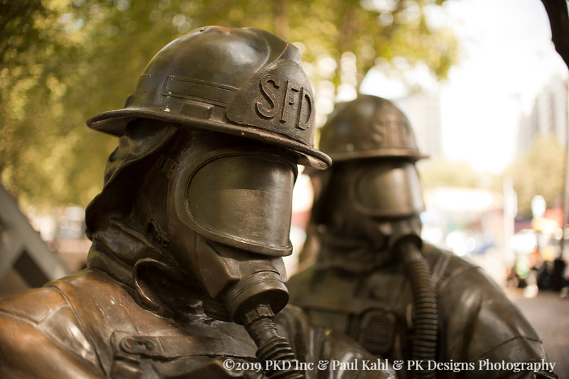 Statues of Seattle Fire Men in Occidental Park.