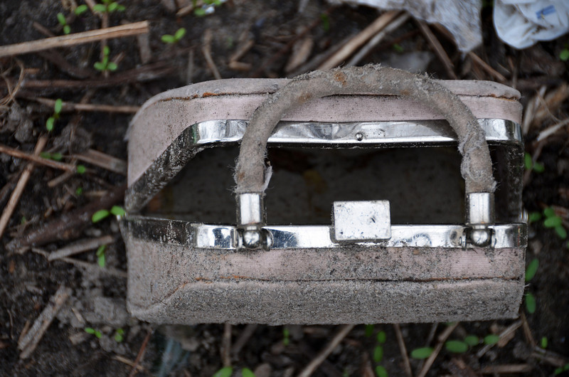 Grumpy purse found abandoned on the shore of the Don River. Toronto. May 2011.