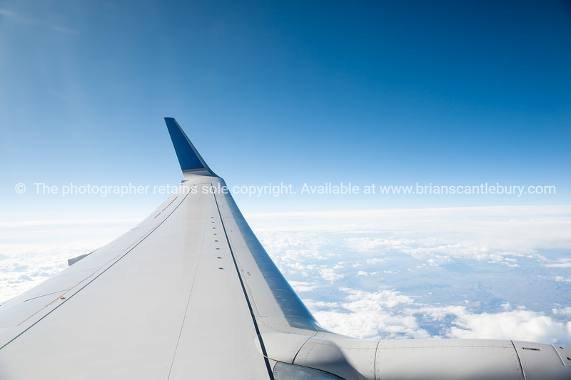 Wing tip above clouds